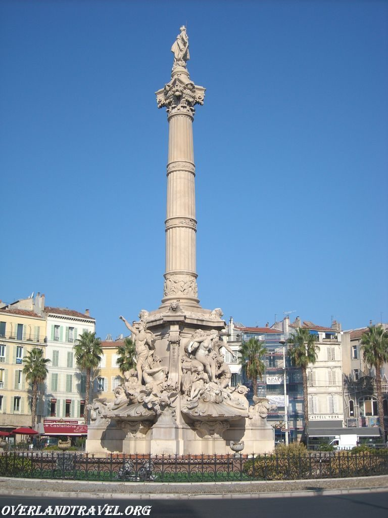 At the intersection of Rue de Rome, Boulevard Baille, Avenues Jules Cantini and du Prado, located Place Castellane. In the center is the magnificent fountain built in 1911. At the top of the pedestal of the statue symbolizes Marseille.
